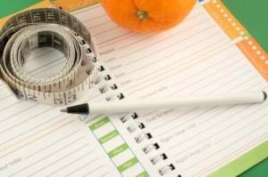 Terminkalender und Maßband